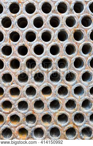 Pipe Tube Sheet Or Plate Of Heat Exchanger Or Boiler Closeup Corrosion Texture Background With Insol