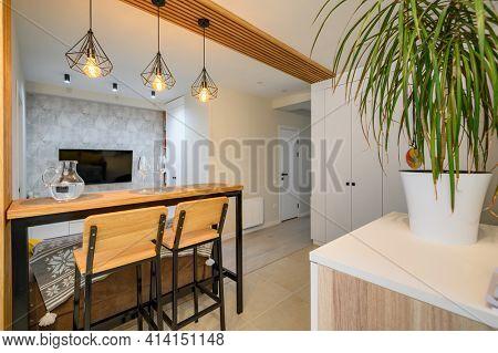 Modern brand new orange, white and teal kitchen interior with dining zone, clean design