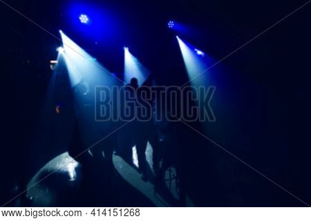 White Spotlights In The Dark With Blue Club Lighting On The Dance Floor With People Dancing Near The