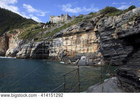 Portovenere ( Sp ), Italy - April 15, 2017: Cliff Around San Pietro Church, Portovenere Gulf Of Poet