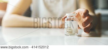 Womans Hand Reaching For Pill Bottle. Painkillers And Antidepressants. Banner Copy Space