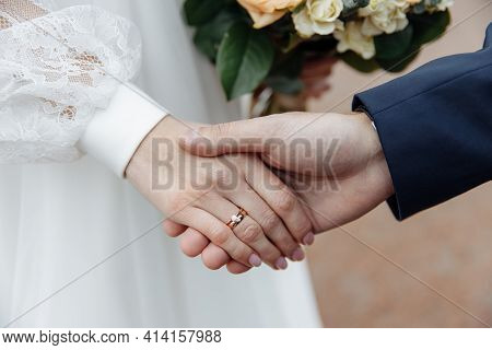 Wedding Day. The Hands Of The Bride And Groom Gently Caress Each Other. Wedding Ring. Happy Day. Wed