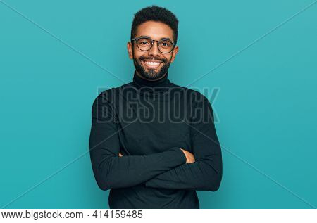 Young african american man wearing casual clothes happy face smiling with crossed arms looking at the camera. positive person.