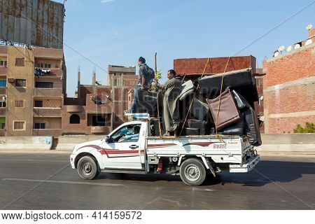 Cairo, Egypt - 15th October 2012: Men move furniture on an overloaded van in Cairo, Egypt.