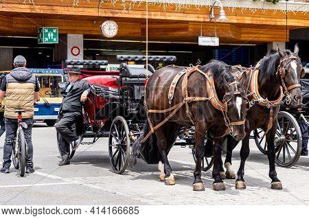 Zermatt, Switzerland - June 22, 2019: Horse-drawn Vehicle For Tourists In The Centre Of Zermatt Town