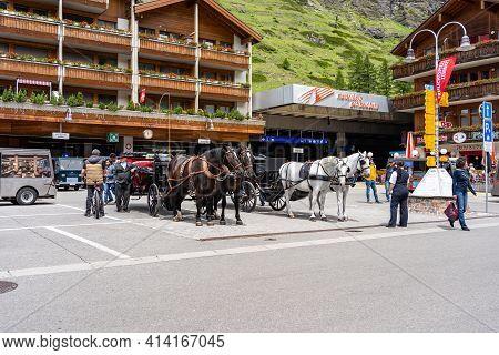 Zermatt, Switzerland - June 22, 2019: Horse Carriage Vehicle For Tourists In Zermatt Town, Switzerla