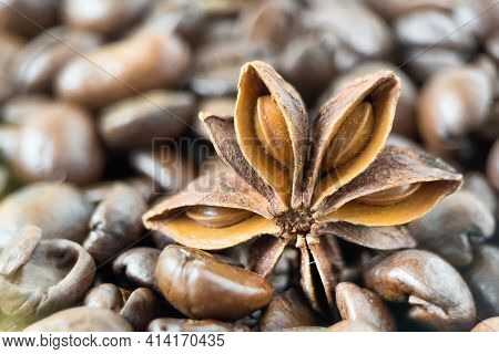 Roasted Coffee Beans With Anise Star Closeup. Macro Photo Of Coffee Beans With Anise Spice.