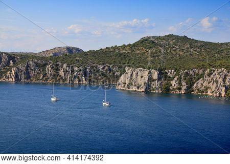 Sailboats And Mussel Farms At River Krka Estuary In Croatia. Croatian Landscape.