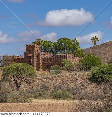 Namib Desert, Namibia - January 8.2021: Duwisib Castle In Namib Naukluft National Park With Blue Sky