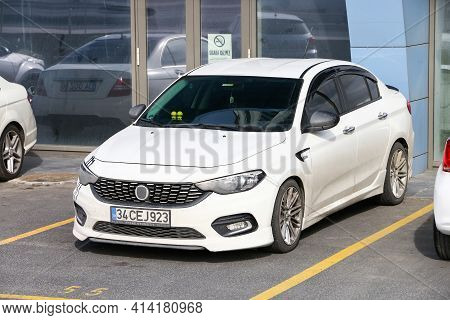 Istanbul, Turkey - February 11, 2021: White Compact Car Fiat Egea In The City Street.
