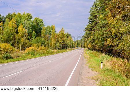 Picturesque Asphalt Road In Autumn Near The Village Of Melnikovo, Leningrad Oblast, Russia