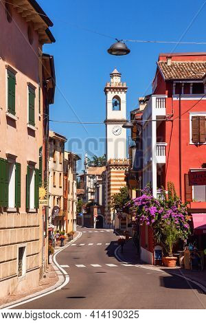 Brenzone sul Garda, Italy - Aug 8, 2016: Winding street of resort town on the eastern shore of Lake Garda, the largest lake in Italy and a popular holiday location on the edge of the Dolomites