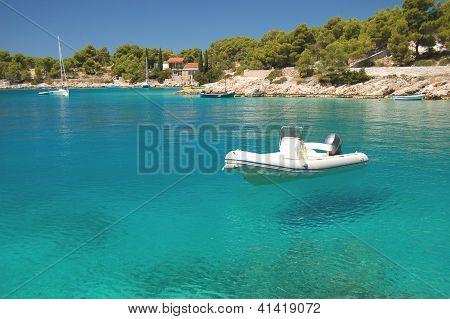 Motorboat in a quiet bay on Brac island in Croatia