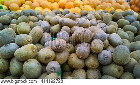 Kiwi Fruit Background. Fresh Food On Supermarket Shelves Or Marketplace. Chinese Gooseberry. Whole K