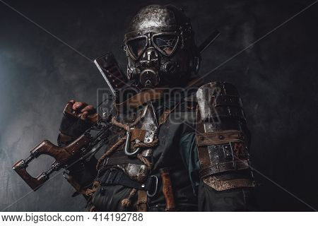 Survivor With Custom Armour And Gun Poses In Dark Background