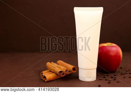 Mockup Of White Cosmetic Tube With Facial Moisturizer Cream Or Cleanser, Cinnamon, Apple And Pepperc