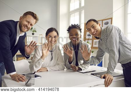 Team Of Business People Waving Hello At Camera Greeting International Coworkers In Online Meeting