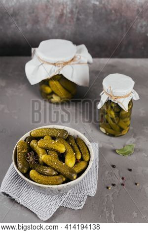 Homemade Canning. Marinated Cucumbers Gherkins With Dill And Garlic In A Glass Jar On The Grey Concr