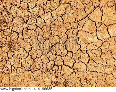 The Texture Of The Dried Ground With Clay And Sand, Close-up. Dry Soil Texture On The Ground. Backgr