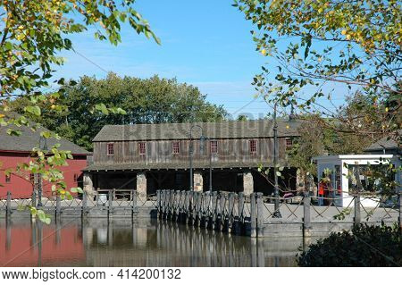 DEARBORN, MICHIGAN - 29 SEPT 2006: Pond and buildings at the Henry Ford Museum.
