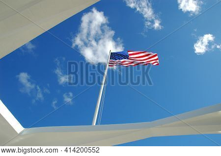 American flag flying over the USS Arizona Memorial at Pear Harbor, Oahu, Hawaii.