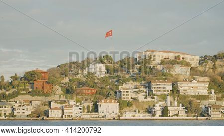 Istanbul, Turkey - March, 2021: Turkish Cape With Town. Action. Flag Of Turkey Is Located On Hill Wi