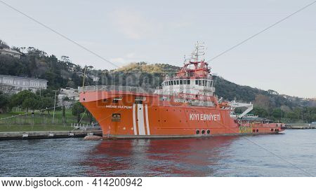 Istanbul, Turkey - March, 2021: Red Ferry Near Coast. Action. Large Red Ferry Moored To Coast Of Tur