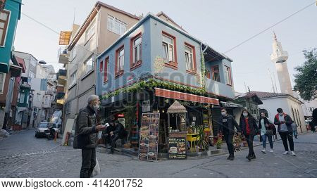 Istanbul, Turkey - March, 2021: Pedestrian Alleys In Istanbul. Action. Tourists Walk Through Small A