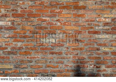 Old Vintage Brick Wall Background Texture With Yellow And Red Brick