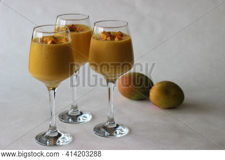 Mango Smoothie, A Cool And Tempting Mango Fruit Drink Prepared By Blending Chopped Ripe And Sweet Ma