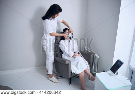 Young Dark-haired Woman Undergoing The Oxygen Therapy