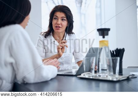 Experienced General Practitioner Consulting Her Female Patient