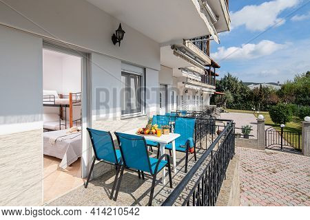 Summer Garden View Of Modern Studio Room Apartment With Outside Open Terrace On White Pavement Floor