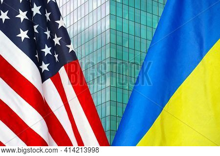 Flag Of Usa And Ukraine Flag Close-up. The Concept Of Political And Economic Relations Of States