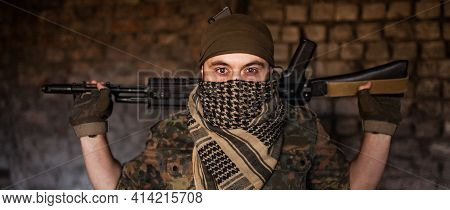 Arab Male Soldier In A Headdress From The National Keffiyeh With Weapons In His Hands. Muslim With F