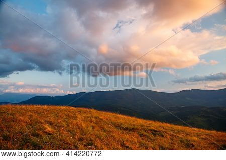 Picturesque view of the colorful valley in the evening. Location place of Carpathian mountains, Ukraine, Europe. Scenic image of textured sky in summer. Photo wallpaper. Discover the beauty of earth.