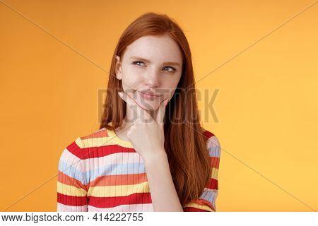 Hmm Interesting. Doubtful Attractive European Redhead Female Pondering Choice Look Hesitant Thoughtf