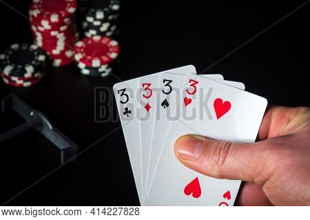 Poker Cards With Four Of A Kind Or Quads Combination. Close Up Of A Gambler Hand Is Holding Playing