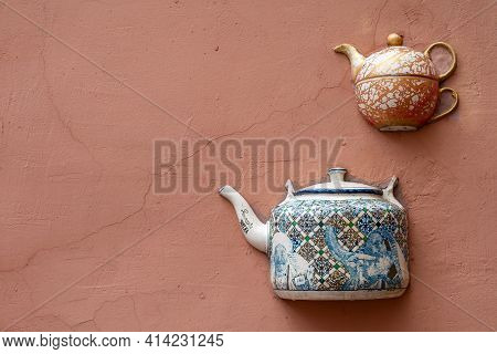 Vilnius, Lithuania - March 14, 2021: Decorative Ceramic Teapot Set Into The Wall Of A Tea Shop In Pi