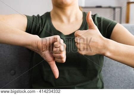 Confused Undecided Woman Showing Thumbs Up Down Gesture