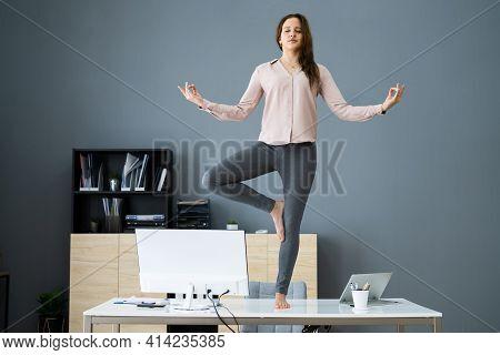 Yoga Meditation In Office. Business Woman Meditating