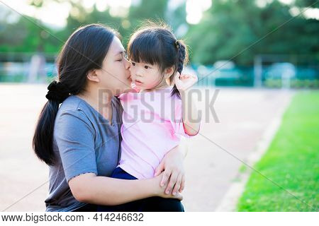 Mother Embraced Her Touchy Daughter And Kissed Her Cheek. Family That Understands Each Other. Warm F