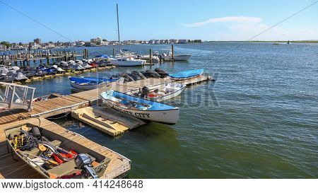 MARGATE CITY NEW JERSEY - JULY 6, 2018: Small boats at Margate city marina in back waters of Atlantic ocean