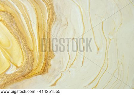 Abstract Fluid Art Background Light Yellow And Golden Colors. Liquid Marble. Acrylic Painting On Can