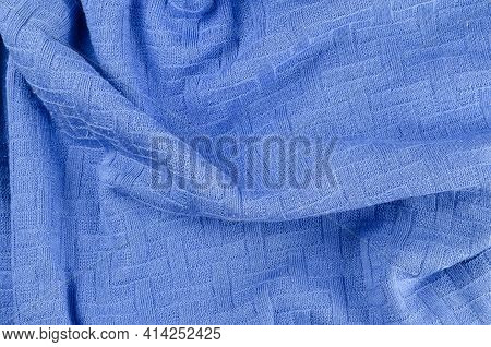 Crumpled Blue Fabric Background. Crumpled Sweater. Casual Wear. Abstract Background.