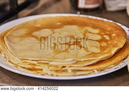 A Stack Of Ready-made Pancakes On A White Plate. Step By Step Recipe.