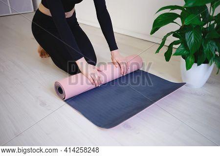 Female Hands Unfold Yoga Mat Preparing For Practice