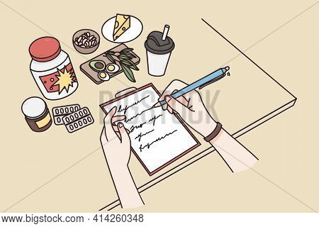 Healthy Lifestyle, Daily Ration, Ingredients Concept. Top View Of Female Hands Writing Daily Menu Wi