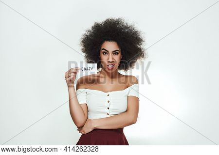 Going Crazy Young Angry Afro American Woman Making A Mad Face And Holding A Piece Of Paper Which Is