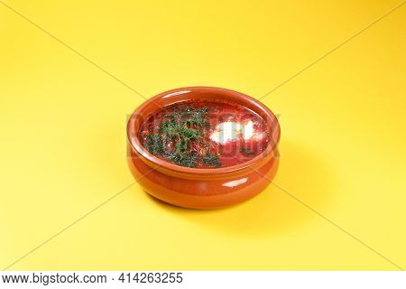 Russian Red Soup Borsch With Dill And Sour Cream In Clay Plate.